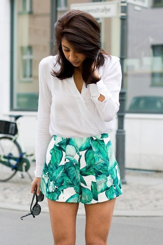 How to wear: white long sleeve blouse, white and green print shorts, black sunglasses