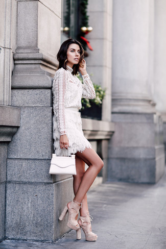 How to wear: white eyelet long sleeve blouse, white fringe mini skirt, beige suede heeled sandals, white leather clutch