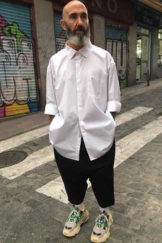 How to wear: white long sleeve shirt, black chinos, beige athletic shoes, white socks