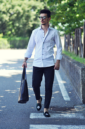 Who said you can't make a style statement with a casual ensemble? You can do so with ease in a white button-down shirt and black chinos. Tap into some David Gandy dapperness and complete your ensemble with black embroidered suede loafers. This combination isn't a hard one to nail and it's summer-ready, which is most important when it's extremely hot outside.