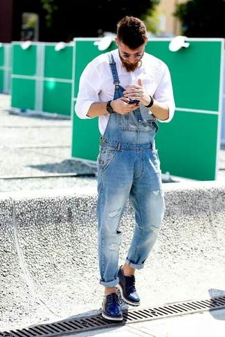 How to Wear Blue Dress Shoes For Men: Inject versatility into your day-to-day off-duty routine with a white long sleeve shirt and blue denim overalls. A pair of blue dress shoes easily bumps up the fashion factor of any getup.