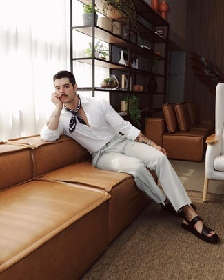 17 Relaxed Outfits For Men: Go for a simple yet casually stylish getup by combining a white long sleeve shirt and grey cargo pants. Hesitant about how to finish? Add a pair of black leather sandals to the mix to shake things up.