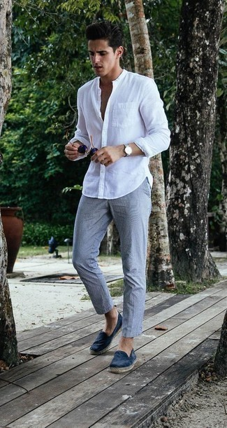 How to Wear Espadrilles For Men: Demonstrate your expertise in men's fashion in this laid-back pairing of a white linen long sleeve shirt and grey chinos. Our favorite of a countless number of ways to complete this outfit is with espadrilles.