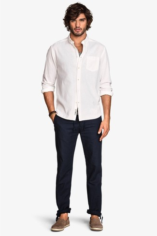 How to wear: white long sleeve shirt, grey tank, navy chinos, brown suede espadrilles
