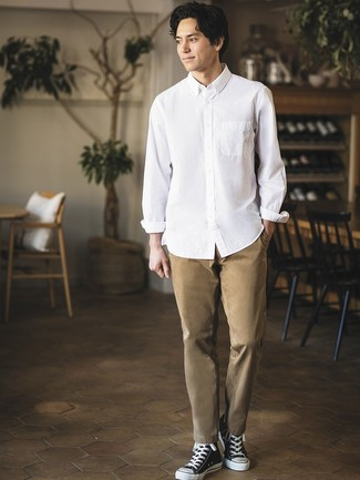 How to wear: white long sleeve shirt, khaki chinos, black and white canvas high top sneakers