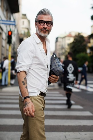 Domenico Gianfrate wearing White Long Sleeve Shirt, Khaki Chinos, Black Leather Belt, Black Leather Watch
