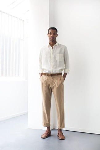 Men's Outfits 2020: If you're after a casual but also on-trend look, dress in a white long sleeve shirt and khaki chinos. Bring an easy-going vibe to by finishing off with brown leather sandals.