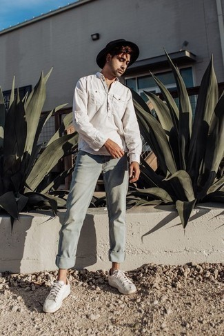 How to Wear a White Long Sleeve Shirt For Men: To achieve a relaxed casual menswear style with a twist, team a white long sleeve shirt with mint jeans. When not sure as to what to wear in the footwear department, add a pair of white canvas low top sneakers to the equation.