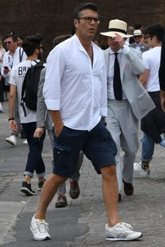 Men's Outfits 2021: If you wish take your casual game up a notch, go for a white long sleeve shirt and navy shorts. Rounding off with white athletic shoes is a surefire way to infuse a carefree touch into your outfit.