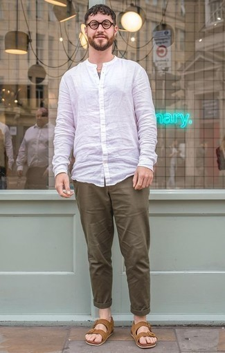Dark Green Pants with White Shirt Relaxed Hot Weather Outfits For Men: Why not dress in a white shirt and dark green pants? Both pieces are super comfortable and look nice matched together. Complete this outfit with a pair of tan suede sandals for extra fashion points.