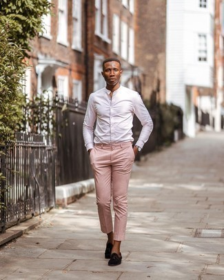 Dark Brown Suede Tassel Loafers Outfits: To pull together a relaxed outfit with a twist, try pairing a white vertical striped long sleeve shirt with pink chinos. A cool pair of dark brown suede tassel loafers is an effortless way to transform this look.