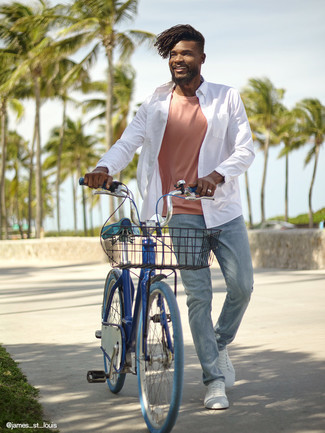 Pink Crew-neck T-shirt Outfits For Men: This pairing of a pink crew-neck t-shirt and light blue jeans will hallmark your skills in men's fashion even on off-duty days. Add a pair of white canvas low top sneakers and the whole ensemble will come together wonderfully.