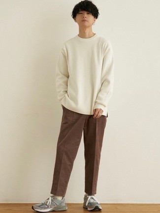 Brown Corduroy Chinos Warm Weather Outfits: Flaunt your skills in menswear styling by marrying a white long sleeve t-shirt and brown corduroy chinos for a casual outfit. And if you wish to immediately tone down your look with one single item, why not complete your getup with grey athletic shoes?
