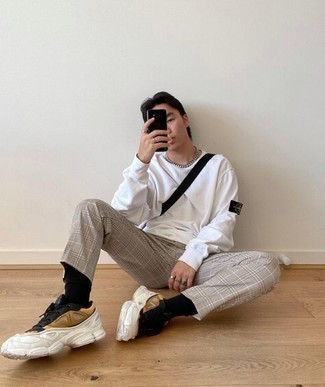 Men's Outfits 2020: A white long sleeve t-shirt and grey plaid chinos teamed together are a smart match. Ramp up this outfit by finishing off with a pair of multi colored athletic shoes.
