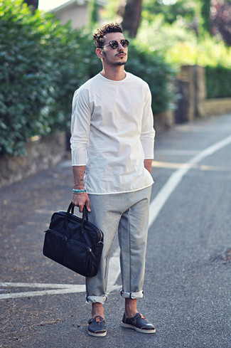 How to wear: white long sleeve t-shirt, grey chinos, navy leather sandals, navy leather briefcase