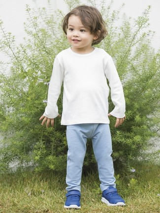 A white long sleeve t-shirt and light blue sweatpants are a nice outfit for your boy to wear when you go on walks. This ensemble is complemented really well with blue sneakers.