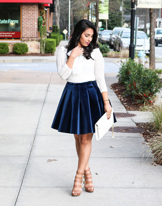 How to wear: white lace long sleeve t-shirt, navy velvet skater skirt, tan leather gladiator sandals, white leather clutch