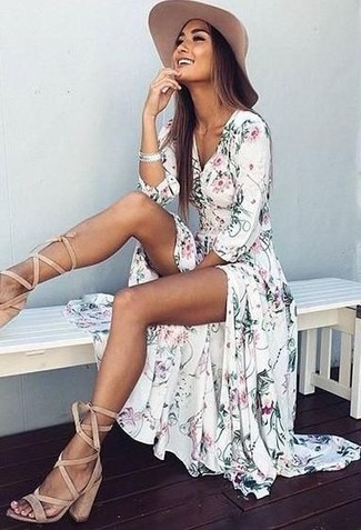 Opt for comfort in a white floral maxi dress and a hat. Make beige suede gladiator sandals your footwear choice for a more relaxed feel. As this ensemble suggests, you can't think of a better idea for hot weather.