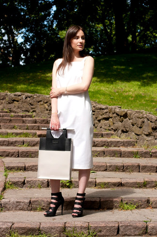 How to wear: white midi dress, black leather gladiator sandals, white and black leather tote bag