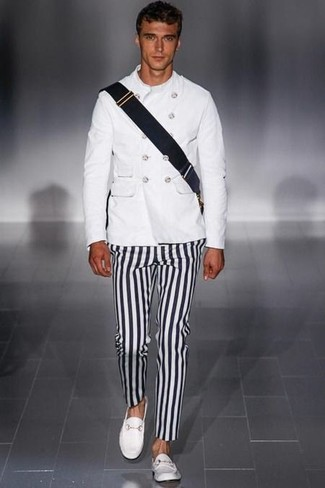 How to wear: white military jacket, black and white vertical striped chinos, white leather loafers, black canvas messenger bag