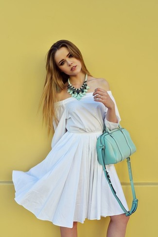 How to Wear a Green Necklace Casually: For a casual and cool getup, try pairing a white off shoulder dress with a green necklace — these two pieces work well together.