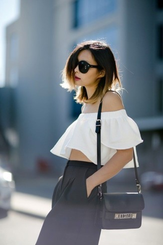 Stay stylish on busy days in a white ruffle off shoulder top and black culottes. There are many ways to look good and survive the roasting hot weather, and this here is one of them.