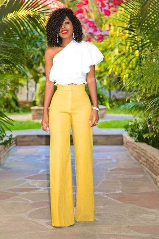 A white ruffle off shoulder top and 3.1 Phillip Lim Wool Drawstring Waist Wide Leg Pants are both versatile essentials that will give your outfits a subtle modification. Seeing as it's super hot outside, this look seems perfect and entirely summer-friendly.