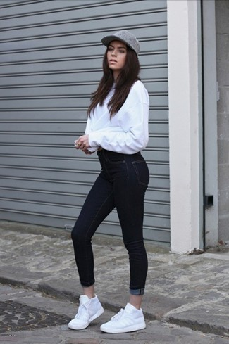 Choose an oversized sweater and black skinny jeans for an easy to wear look. Rock a pair of white running sneakers for a more relaxed aesthetic.