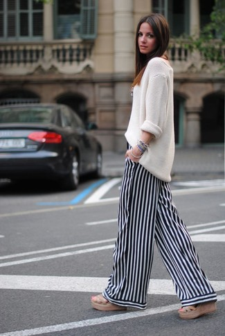 How to wear: white knit oversized sweater, white and black vertical striped wide leg pants, tan woven sandals, blue bracelet