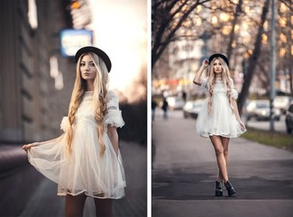 A white tulle party dress couldn't possibly come across as other than strikingly elegant. Black leather lace-up flat boots will add a more relaxed feel to your getup. Mastering transitional fashion is easy with style inspiration like this.