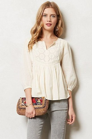 Master the effortlessly chic look in a peasant blouse and grey jeans.