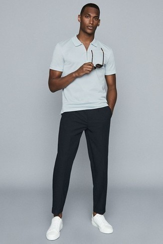 How to Wear Low Top Sneakers For Men: You'll be surprised at how super easy it is for any gent to get dressed this way. Just a white polo matched with black chinos. Our favorite of a ton of ways to finish this look is a pair of low top sneakers.