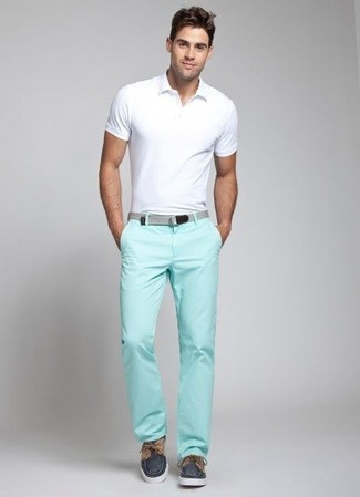 This combo of a white polo and mint chinos spells comfort and style. Complete this look with navy canvas boat shoes. This look is basically a lesson in how to dress for warm sunny weather.