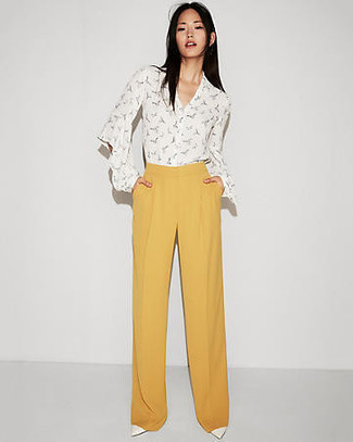 Swing into something classy yet contemporary with a white print button down blouse and yellow wide leg pants. For the maximum chicness grab a pair of white leather pumps. An ensemble like this is perfect for awkward transition weather.