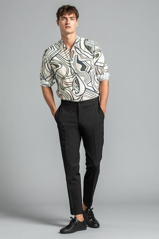 1200+ Outfits For Men In Their 30s: Keep things casual for the day in this functional combination of a white print long sleeve shirt and black chinos. Look at how great this outfit goes with black leather low top sneakers. This ensemble illustrates how to remain fashionable as you head into your 30s.