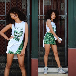 Make a white print tunic and a green print mini skirt your outfit choice for a lazy Sunday brunch. Elevate your getup with grey leather wedge sneakers.