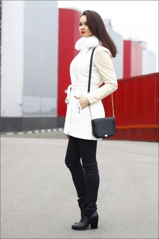 Go for a white puffer coat and black slim jeans to create a chic, glamorous look. Polish off the ensemble with black leather ankle boots.