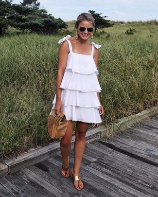 How to wear: white ruffle swing dress, tan leather thong sandals, tan straw clutch
