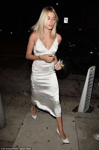 Women's Looks & Outfits: What To Wear In 2020: Opt for a white satin cami dress for an off-duty ensemble with a modern twist. If not sure about the footwear, complete your ensemble with a pair of white leather pumps.