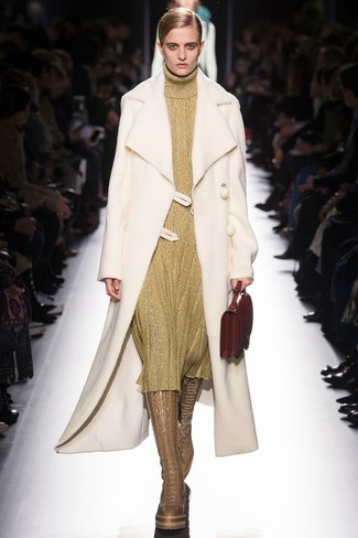 How to wear: white shearling coat, gold sweater dress, tan leather knee high boots, red leather handbag