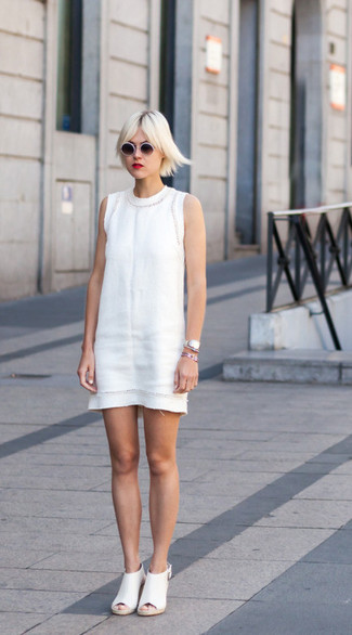 How to wear: white sheath dress, white leather mules, white and black sunglasses, silver watch