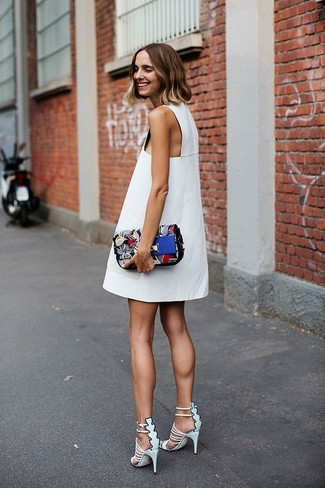 Contrary to what you might believe, looking stylish doesn't take that much time. Just make a white shift dress your outfit choice and you'll look great. As for the shoes, go for a pair of Giuseppe Zanotti Design Alien 115 Cage Sandals. Is there a greater option for a hot summer day?