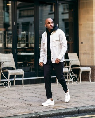 Men's Outfits 2020: Go for a white shirt jacket and black chinos to ooze masculine sophistication and class. Throw a pair of white leather low top sneakers in the mix to keep the ensemble fresh.