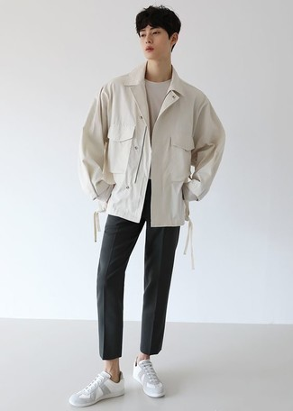 Charcoal Chinos Outfits: Team a white shirt jacket with charcoal chinos to exude masculine elegance and polish. And it's a wonder what white leather low top sneakers can do for the look.