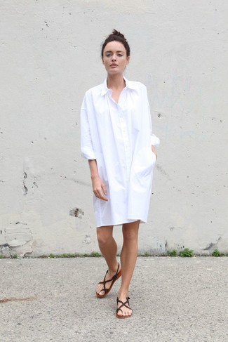 To create an outfit for lunch with friends at the weekend consider wearing a white shirtdress. Thong sandals will add some edge to an otherwise classic getup. A look like this is just what you need to get sartorially inspired this summer season.