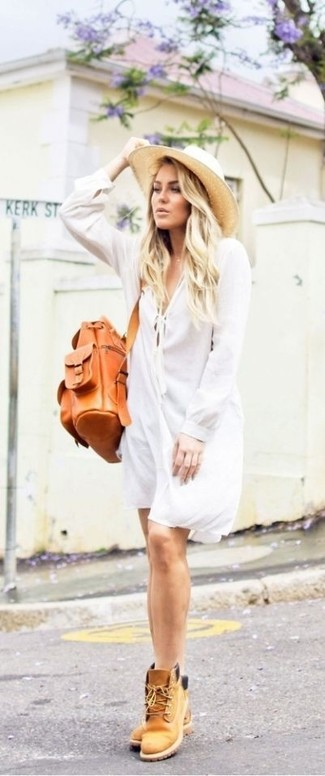 How to Wear Tan Leather Lace-up Flat Boots For Women: When the setting allows casual dressing, you can go for a white shirtdress. With shoes, go down a more casual route with tan leather lace-up flat boots.