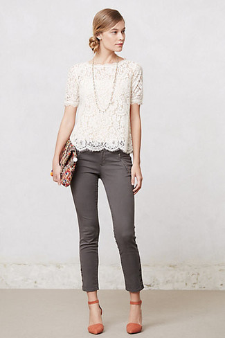 Orange Leather Pumps Outfits: Pairing a white lace short sleeve blouse with grey skinny jeans is a comfortable and stylish option. Balance your look with a smarter kind of footwear, such as these orange leather pumps.