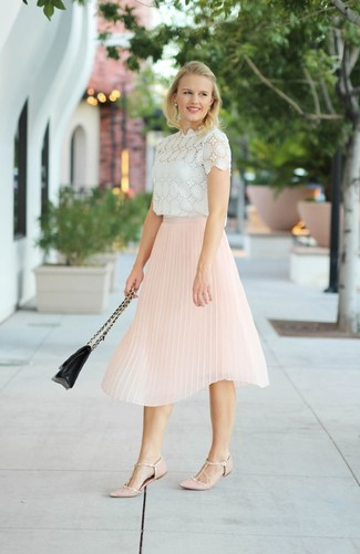 This combo of a white lace short sleeve blouse and a pink pleated midi skirt will attract attention for all the right reasons. A pair of dusty pink leather ballerina flats will be a stylish addition to your ensemble. Needless to say, it's easier to work through a warm hot weather day in a easy and breezy outfit such as this one.