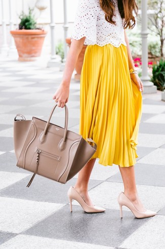 Opt for a white eyelet short sleeve blouse and a tan leather tote bag to bring out the stylish in you. Polish off the ensemble with beige leather pumps. So as you can see, this is a knockout pick for summertime.