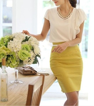 Yellow Pencil Skirt Outfits: For a casual and cool getup, go for a white short sleeve blouse and a yellow pencil skirt — these pieces play really well together.
